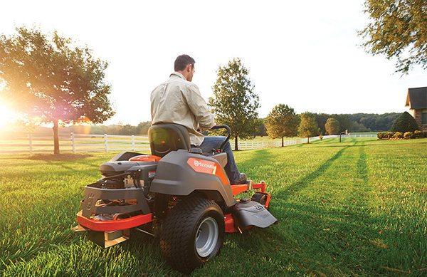 man mowing lawn on riding lawnmower